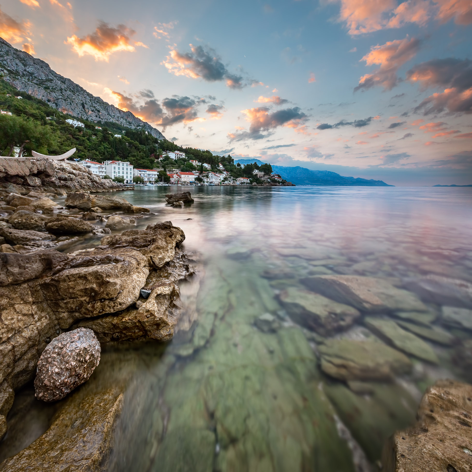 Sunrise on Rocky Beach and Small Village near Omis, Dalmatia, Croatia
