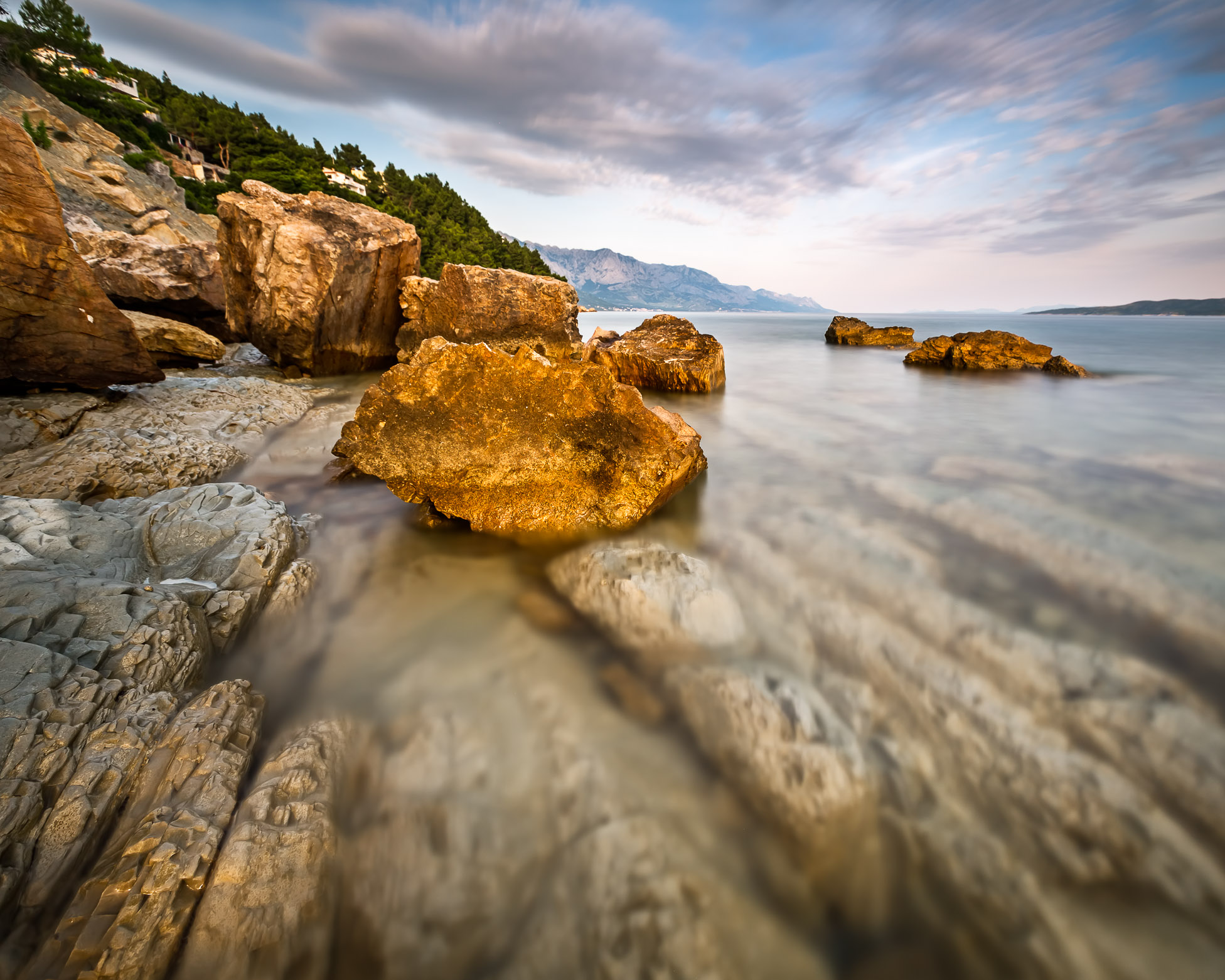 Rocky Beach and Transparent Adriatic Sea near Omis in the Evening, Dalmatia, Croatia